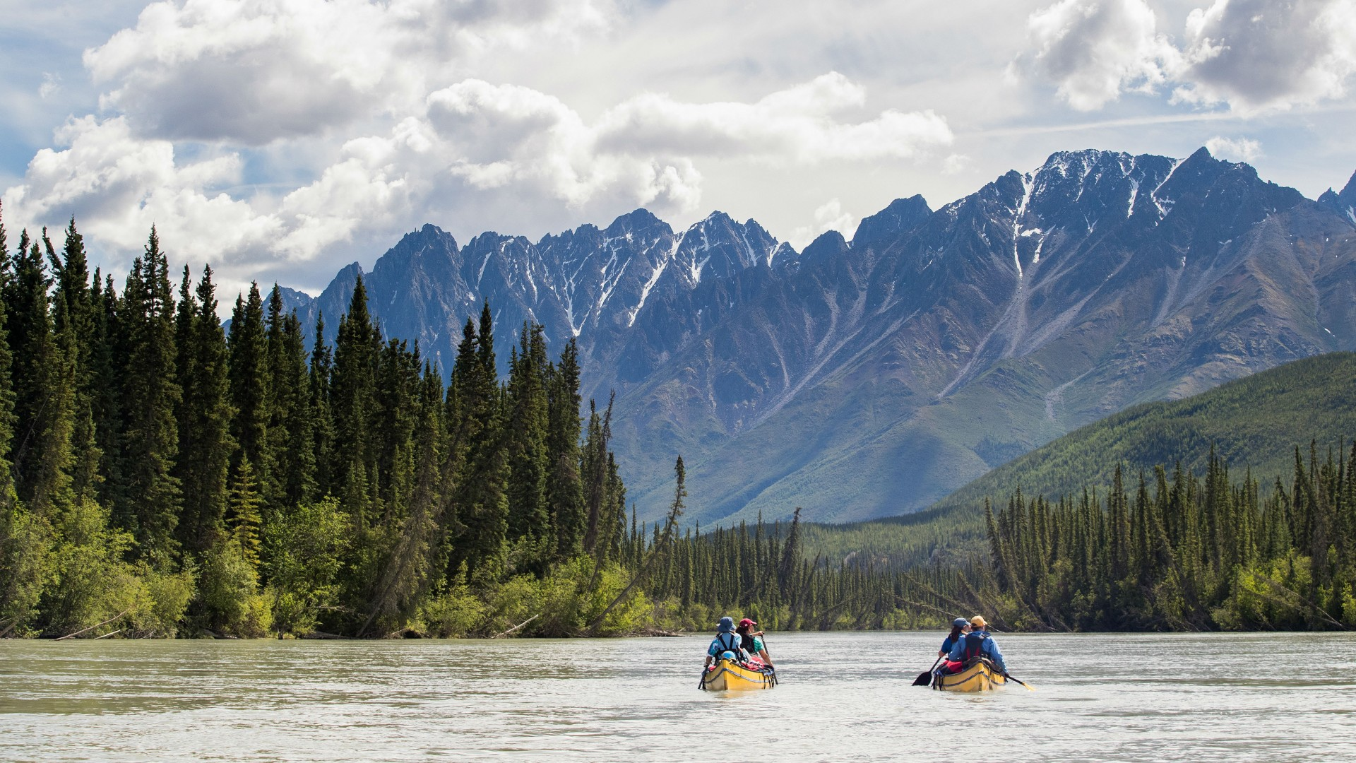 Canoe through canyons on the South Nahanni River