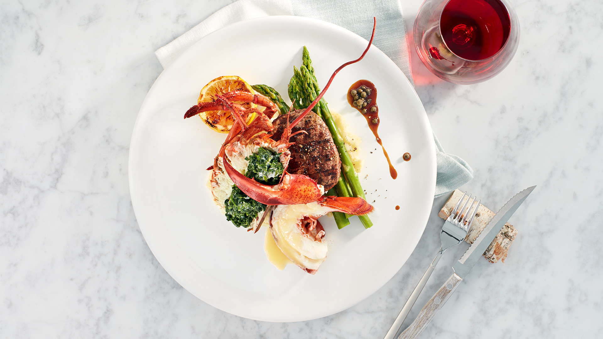 Win dinner for two at the CN Tower's 360 Restaurant | Steak and lobster dish