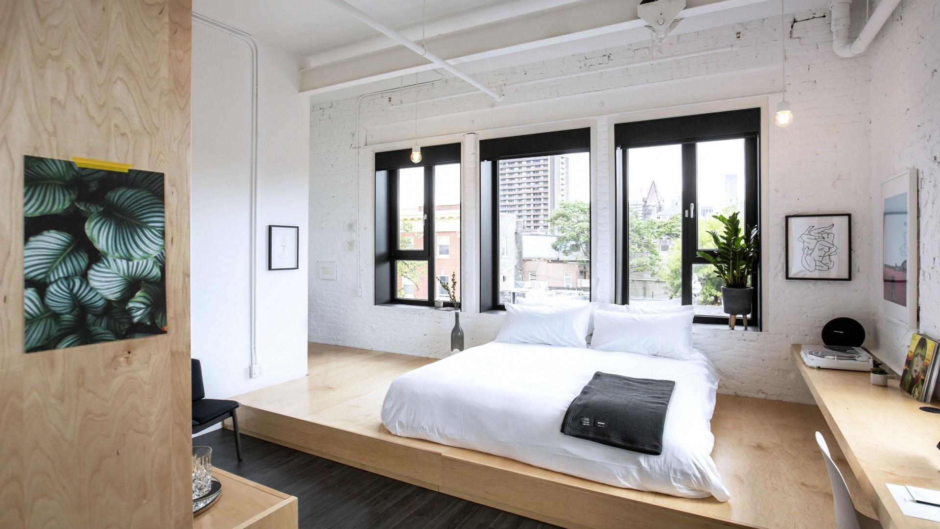 Best hotels Toronto staycation | The Annex Hotel bed on raised platform