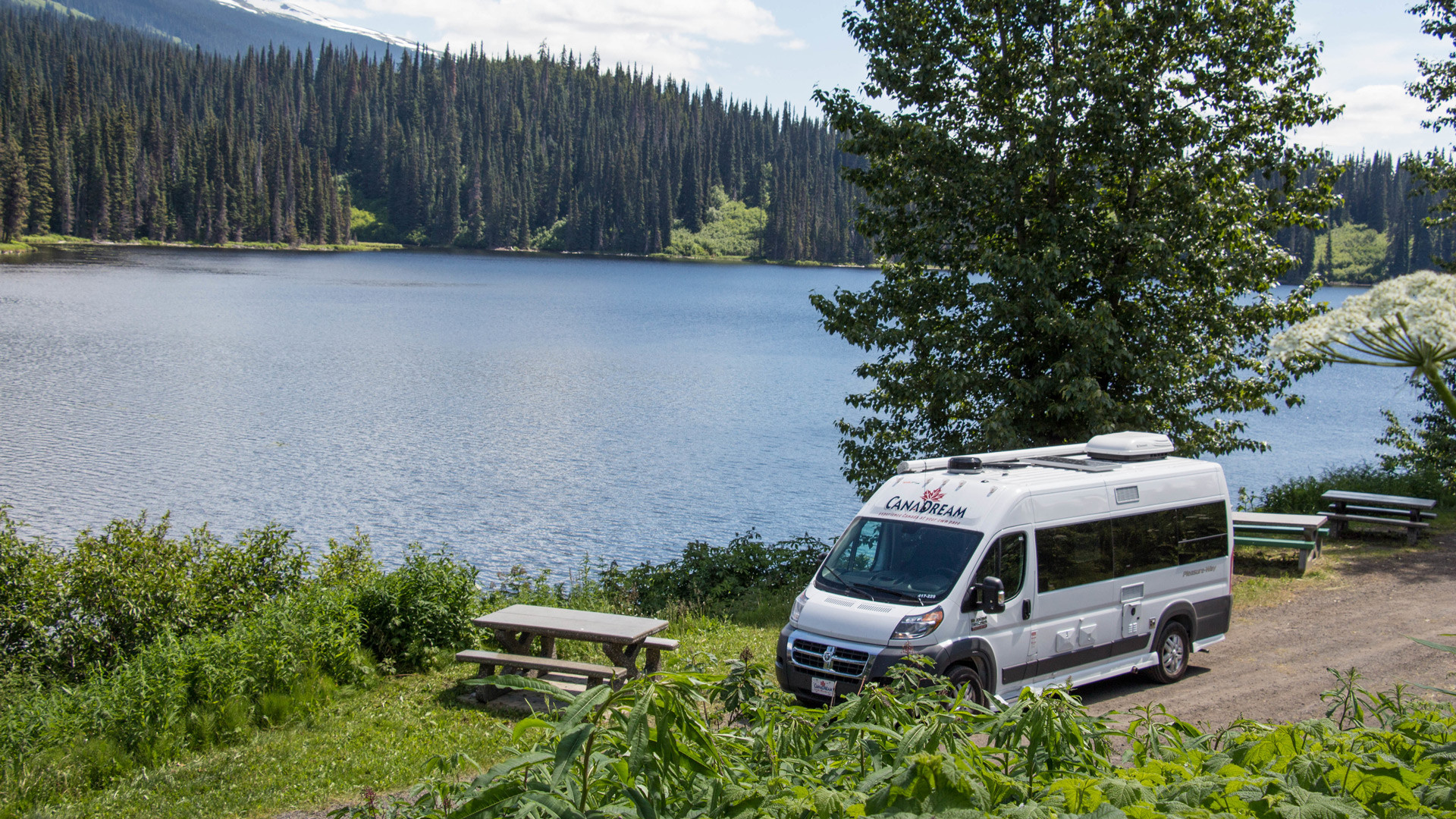CanaDream: RV rentals in Ontario | A CanaDream Deluxe Van Camper parked beside a lake