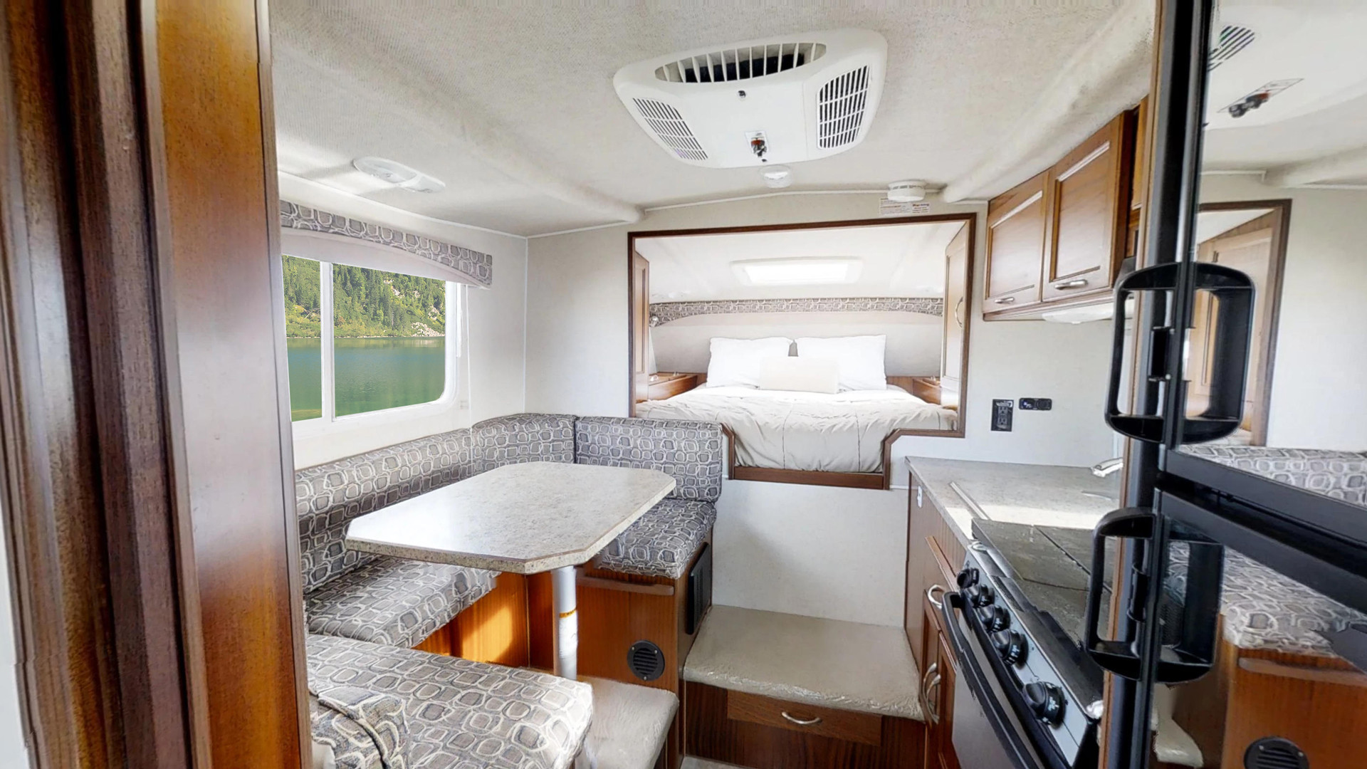 CanaDream: RV rentals in Ontario | The kitchen and sleeping area inside one of CanaDream's vehicles