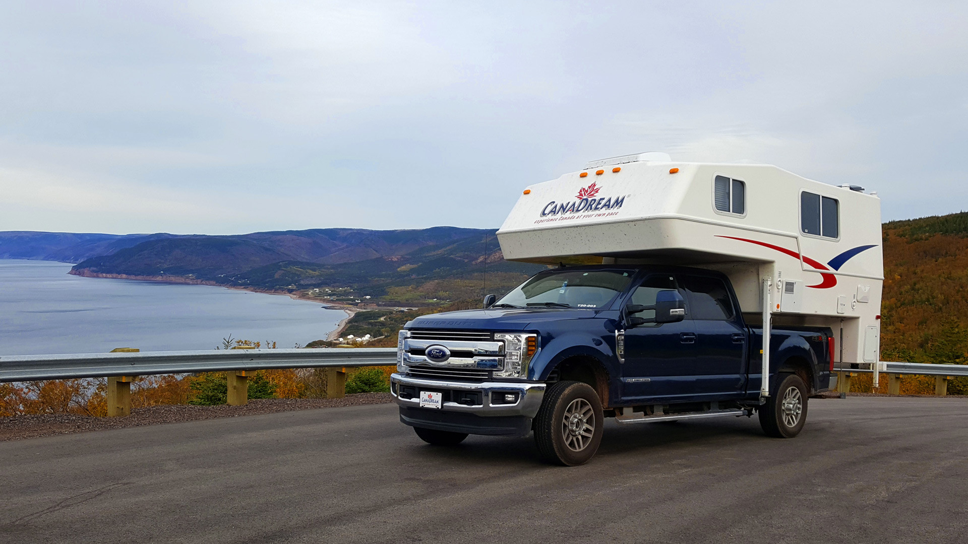 CanaDream: RV rentals in Ontario | A CanaDream Maxi Travel Camper driving by the water