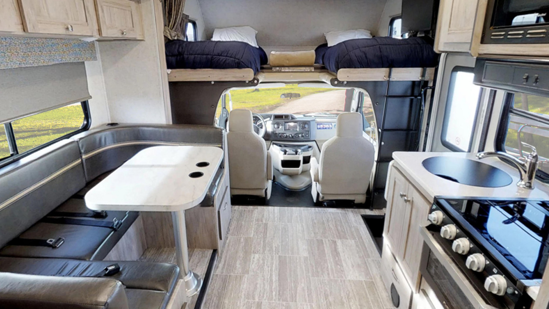 CanaDream: RV rentals in Ontario | The kitchen and sleeping bunks inside one of CanaDream's vehicles