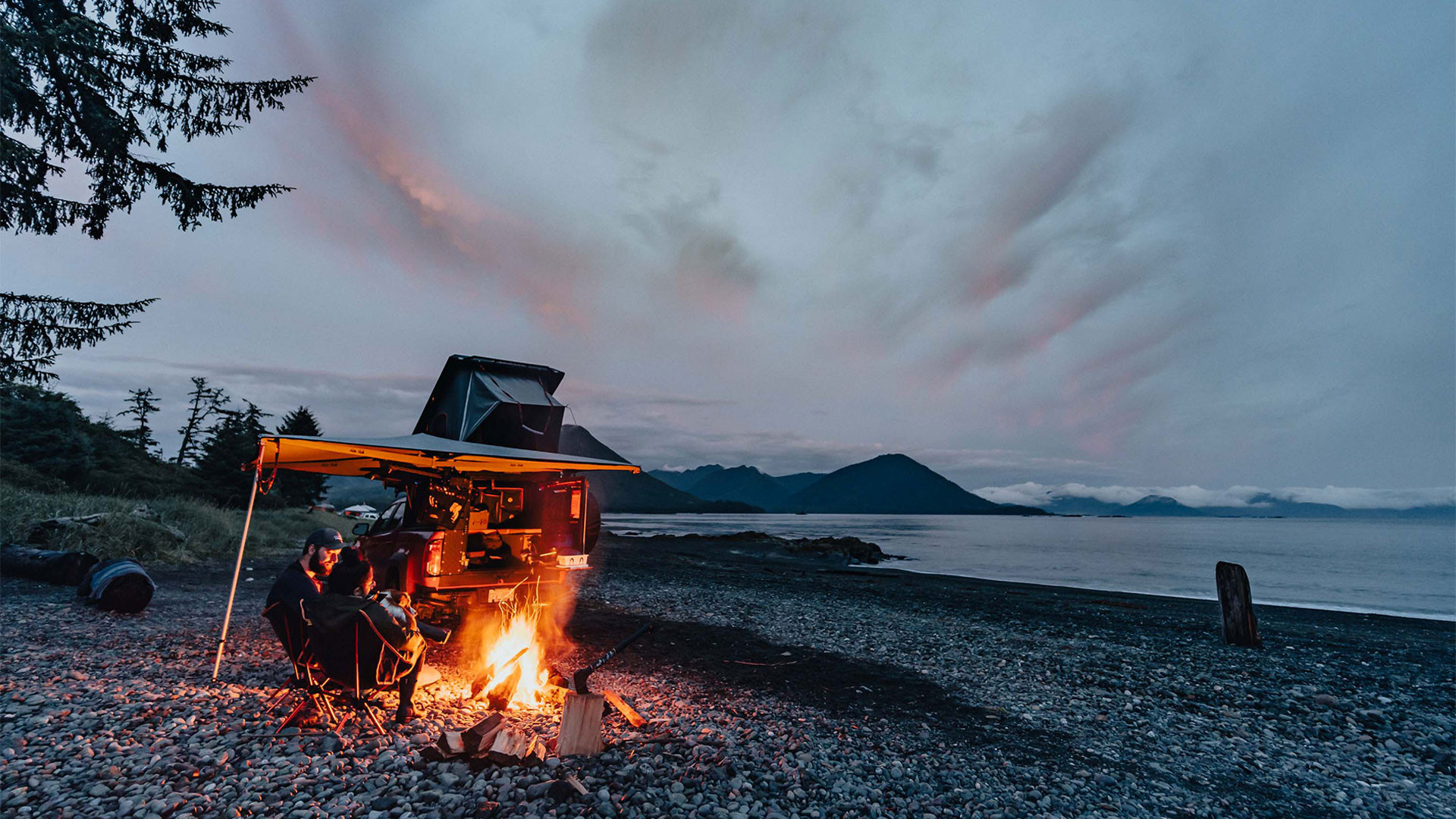 Gears of Travel, Canadian adventure | Chevrolet with canopy camper next to campfire