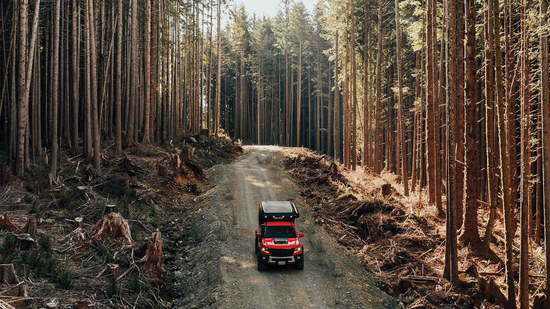 Gears of Travel, Canadian adventure | Chevrolet with canopy camper in forest