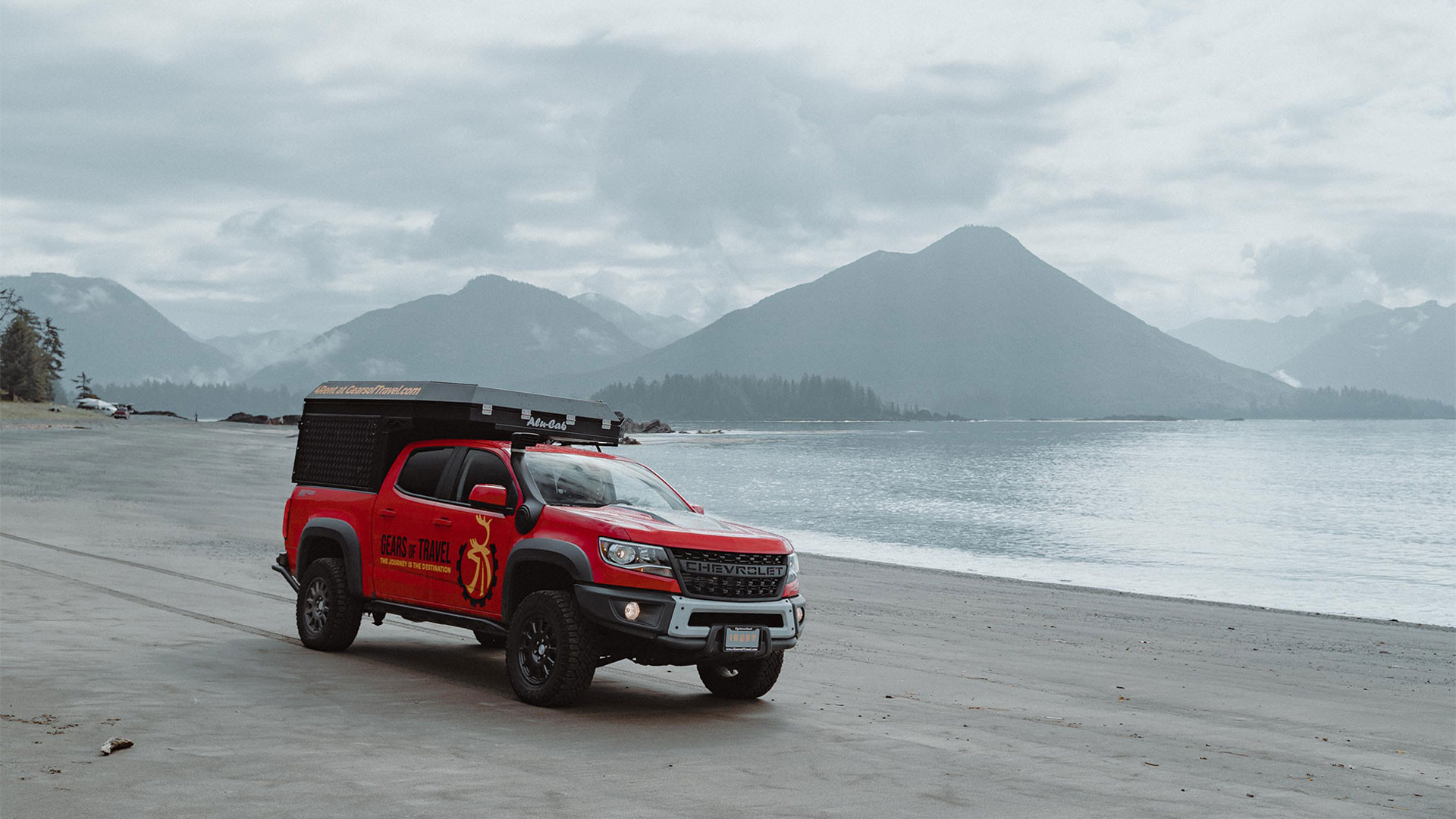 Gears of Travel, Canadian adventure | Chevrolet with canopy camper on beach