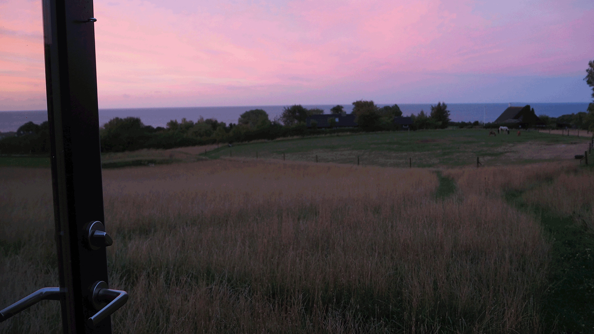 Sunset from the cabin at Bornholm Surf Farm