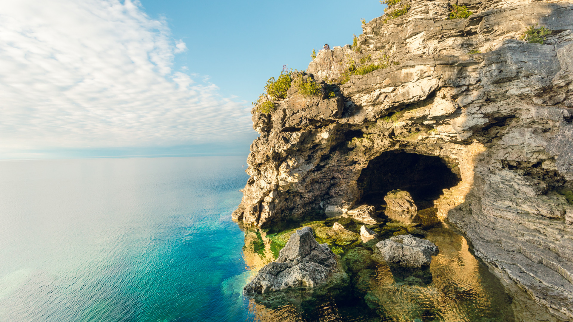 Breathtaking Ontario beaches | The Grotto is a cave with a pool of blue water inside