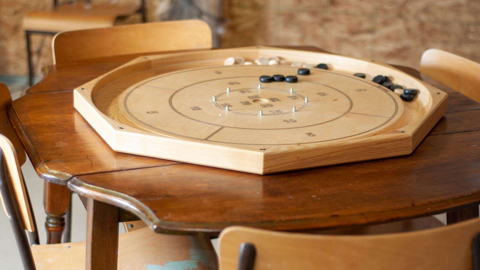 Ontario's coolest cabins to rent | Playing crokinole at the Freija Forest Loft