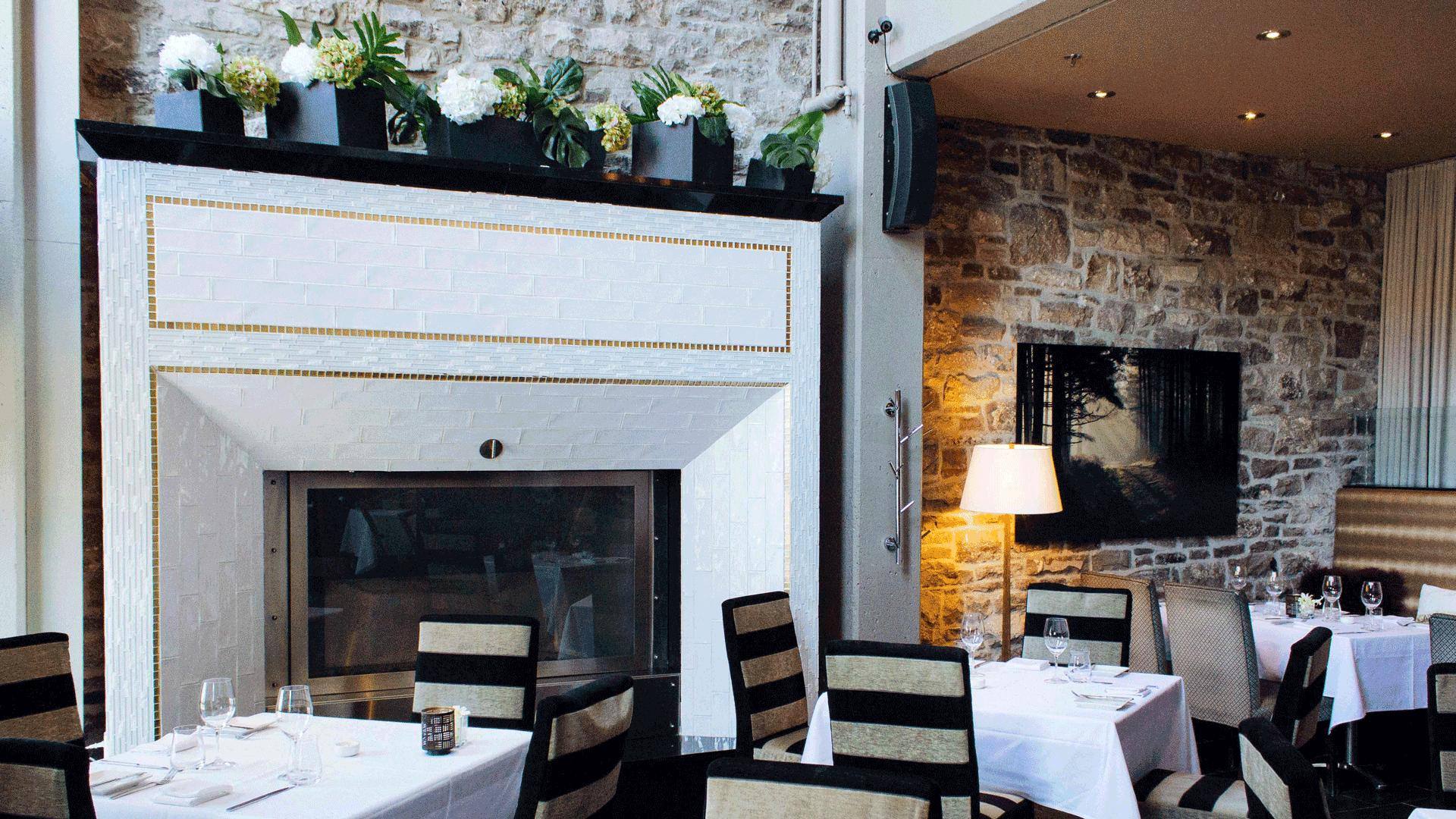 The best things to eat and do in Ottawa | Dining room fireplace at Restaurant e18hteen