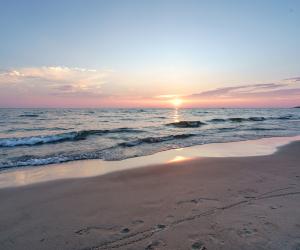 Breathtaking Ontario beaches | A sunset over Sauble Beach on Lake Huron