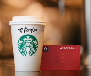 Aeroplan points partners with Starbucks Rewards | A Starbucks coffee next to an Aeroplan card